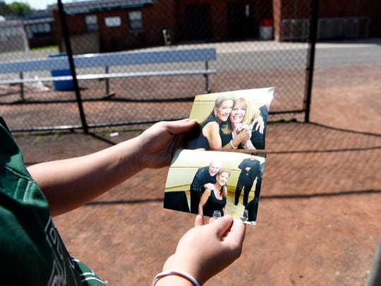 DePaul senior catcher Dominique Coiro holds photos of her mother, whom she lost to cancer in September 2017.