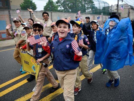 Garfield Cub Scout Pack 205 marches down Midland Avenue during the annual Memorial Day Parade in Garfield, NJ on Sunday, May 27, 2018.