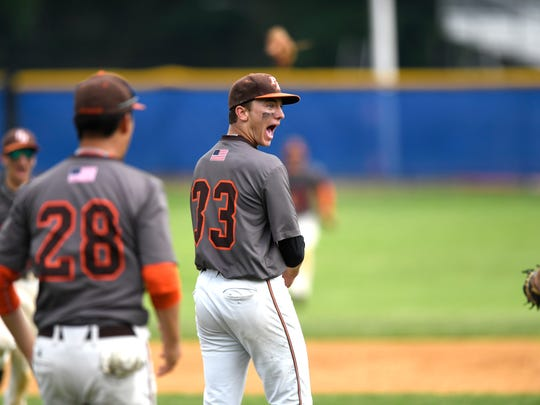 Pascack Hills pitcher Brandon Siegenthaler (33) reacts as Don Bosco strikes out and the Cowboys win the title. Pascack Hills defeated Don Bosco 3-1 in the Bergen County baseball tournament championship in Demarest, NJ on Monday, May 28, 2018.