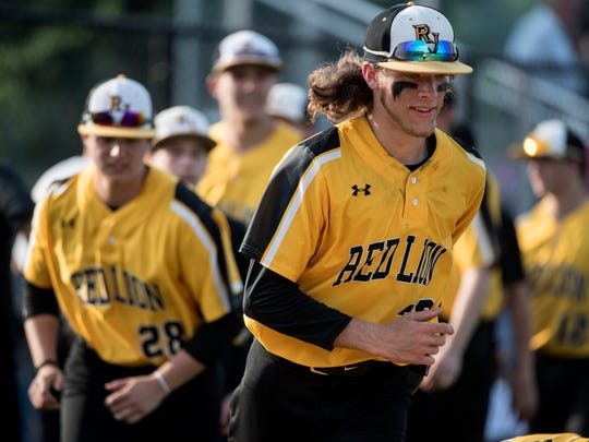 Red Lion's Austin Wildasin jogs to the outfield following the Lions' win over Dallstown. The Red Lion Lions beat the Dallastown Wildcats, 4-1, during the District III Class 6A semifinals at Spring Grove on Tuesday, May 29, 2018.