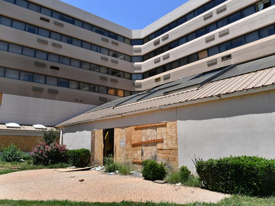 A vacant hotel on Central Freeway, across from the