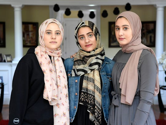 """This is systematic racism,"" Yasmine Elfarra, left, recalls telling the TSA agents who she said singled her out along with her sisters and 11 other women who were wearing hijabs, forcing them to miss a flight to Chicago. ""You lumped us in the group because we look like one another."""