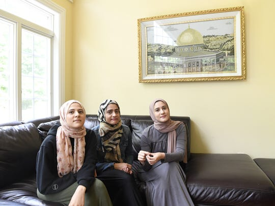 Yasmine Elfarra, 21, left, and her sisters Suzanne, 23, and Sarah, 19, at their home in Wayne. They are among 14 women who filed a complaint against the federal Transportation Security Administration alleging that they were the victims of anti-Muslim bias at Newark Liberty International Airport.