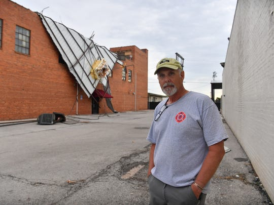 In this file photo downtown resident Bobby Whiteley stands near his property which sustained damage to the roof after a storm. Roof damage is the most reported property damage to homes in Texas.