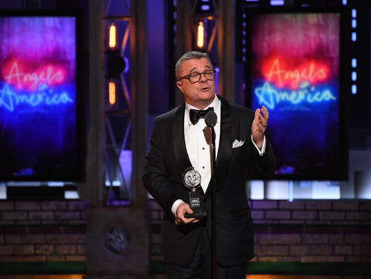 Nathan Lane accepts the award for best performance