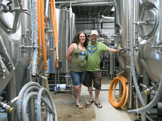 Lisa and Jay Schutz started One World Brewing as a nanobrewery in the basement of Farm Burger downtown. They are now expanding and growing even more to a second location on Haywood Road in West Asheville.
