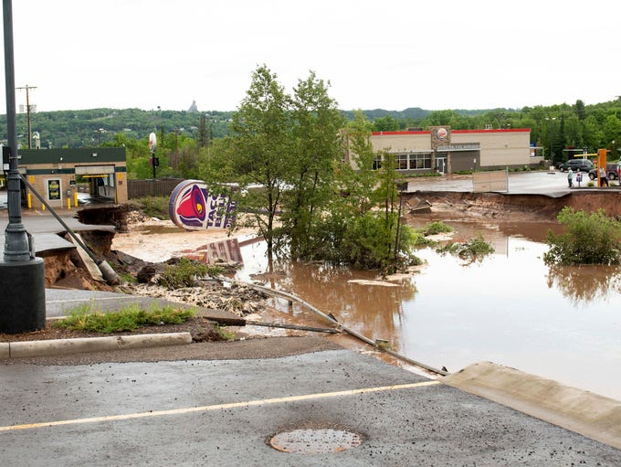 A Taco Bell drive-through caved in and washed away