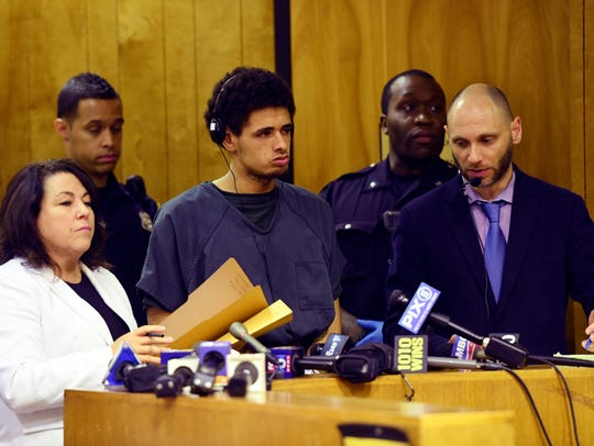 Jose Muniz, center, one of six suspected gang members