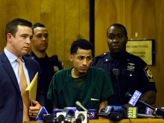 Danel Fernandez, center, one of six suspected gang members arrested for the fatal stabbing of 15-year-old Lesandro Guzman-Feliz, stands with defense attorney Thomas McQuillan, far left, during his extradition hearing in Paterson, NJ on Tuesday, June 26, 2018. Fernandez will go back to New York to face homicide charges.
