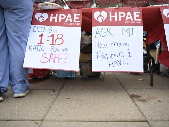 Signs hang at a rally outside of HMH Palisades Medical
