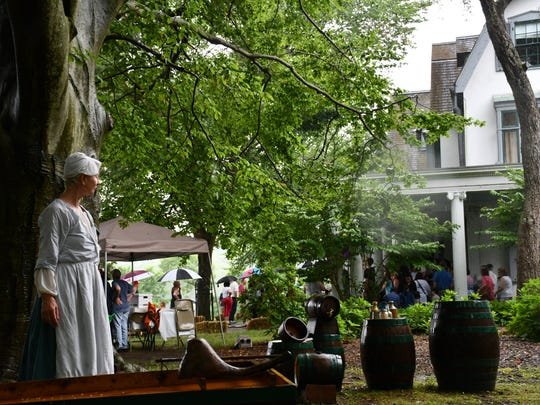 A Revolutionary War-era re-enactor peers at Ridgewood