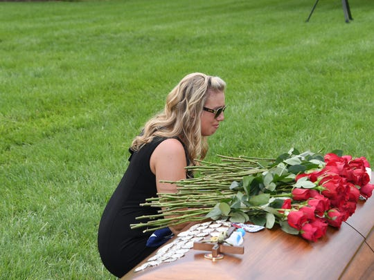 Angela Drzewiecki, the widow of the late Air Force Staff Sgt. Carl Enis, at the burial for her husband.
