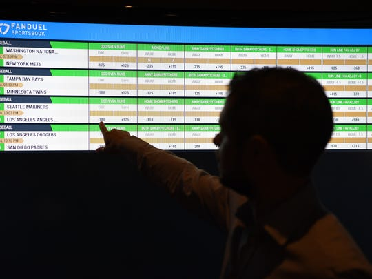 Keith Wall, Head of US Retail at FanDuel, points to a screen displaying the FanDuel Sportsbook at the Victory Sports Bar at the Meadowlands on Thursday, July 12, 2018.
