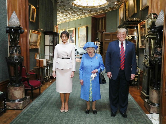 Queen Elizabeth II stands with President Donald Trump