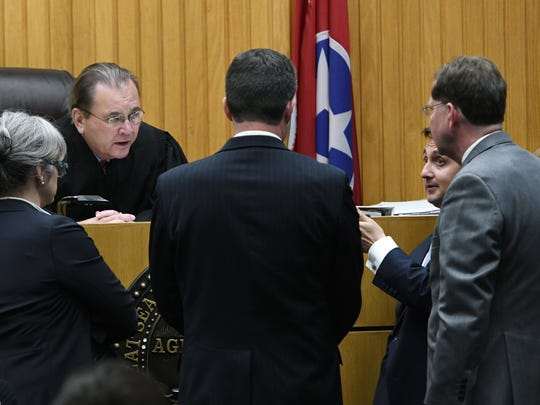 A.J. Johnson's attorney Steve Johnson, second from right, and Michael Williams' attorney David Eldridge, right, during a bench conference with Judge Bob McGee and prosecutors Leslie Nassios and Kyle Hixson Monday, July 16, 2018.