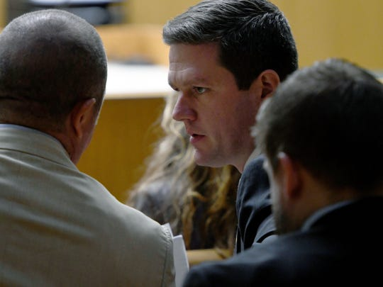 KPD Investigator Tim Riddle and prosecutor Kyle Hixson before Riddle's testimony in the trial of A.J. Johnson and Michael Williams on July 26, 2018.