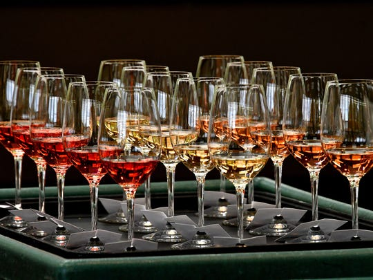 A huge variation in color is visible in the Rose wines awaiting tasting. There were 31 rose wines entered in the competition as judges work their way through Michigan wines during the annual Michigan wine competition held at MSU's Kellogg Center on Tuesday, July 31, 2018.
