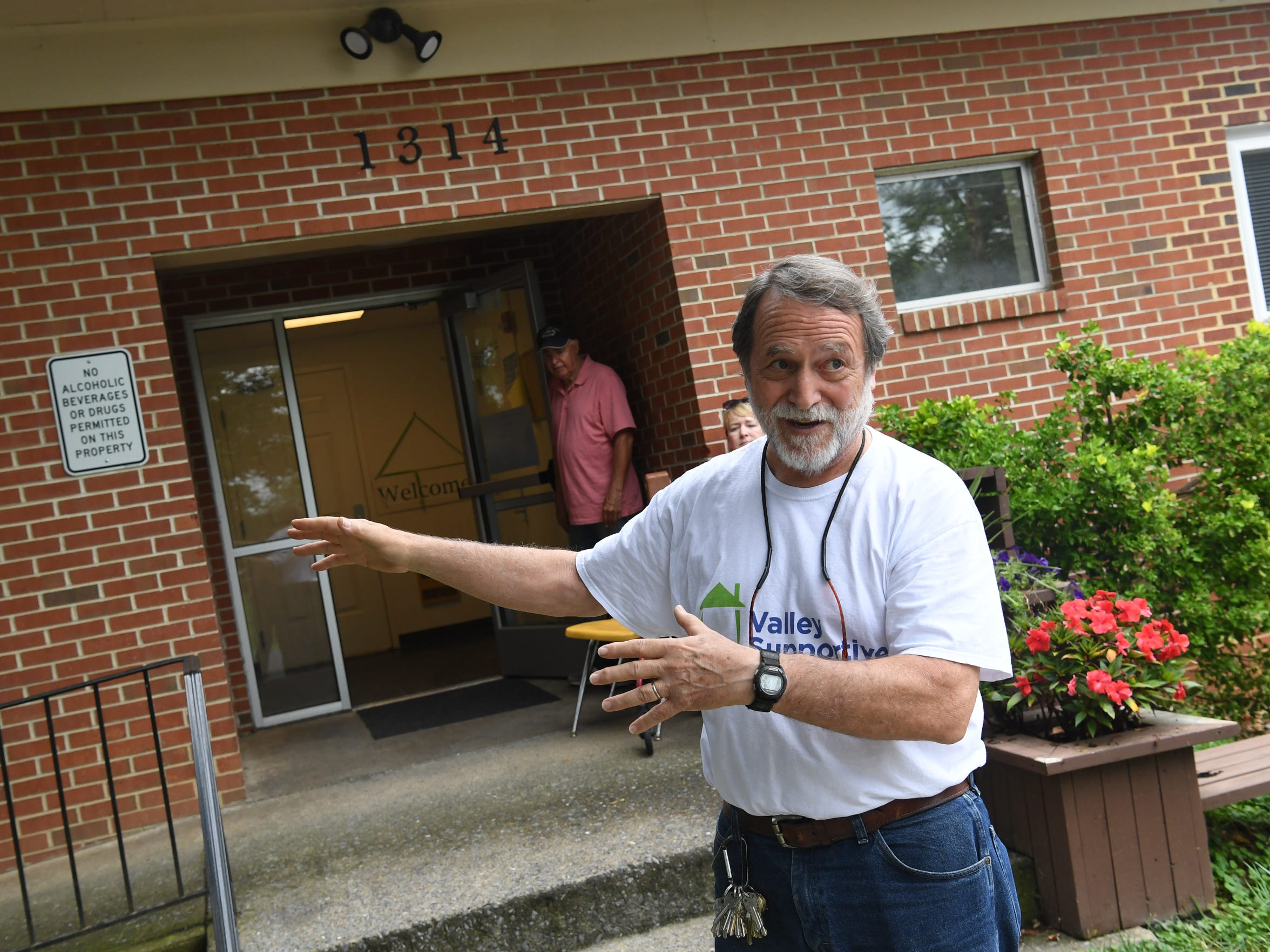 Clark Banta, executive director of Valley Supportive Housing, stands out front of the Johnson Street Apartments. He talks about new apartments being added to the location during an interview in Staunton on Friday, August 3, 2018.
