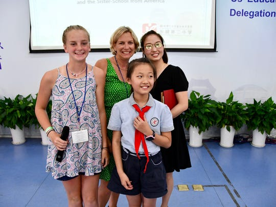 Helen Smith and her mother, Collier, meet their Chinese host family in a ceremony at a Dongcheng Educational Group magnet school in Hangzhou, China.