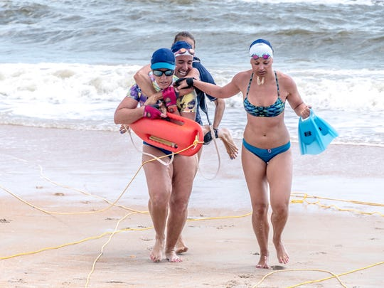 Tiffany-LaCasse-Johnson, Chase Harris, Jessica Ventura-Wald and Jessie Stephens, all from Palm Beach County, race to the finish line during the Land Line Pull Rescue event.
