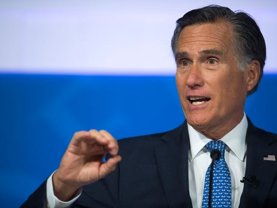 U.S. Senate candidate Mitt Romney (R) answers a question