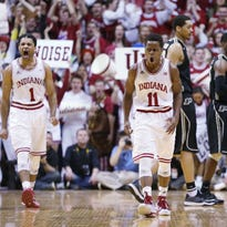 Indiana Hoosiers guard James Blackmon Jr. and teammate Yogi Ferrell do a little yelling with the crowd after a big three point bucket by Ferrell late in the second half. Indiana hosted Purdue at Assembly Hall on Thursday, February 19, 2015.