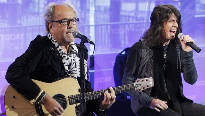 """Mick Jones, left, and Kelly Hansen of Foreigner, perform on the NBC """"Today"""" television program in New York."""