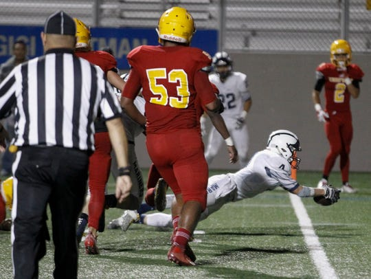 Aptos' Will Murphydives into the end zone for a touchdown