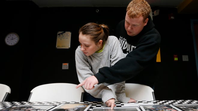 Ashley and Nick Reynolds try to make sense of a possible clue Feb. 7 inside a locked room at Escape Chambers Des Moines. Participants have one hour to solve a series of clues in order to escape from a locked room.