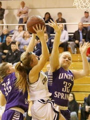 Maura Glovins of Elmira Notre Dame goes up for a shot in between Baylee Wiler, left, and Erin Heindl of Union Springs on Tuesday during a Section 4 Class C first-round game at Notre Dame.