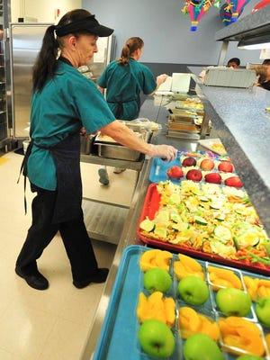 Food being served at Bloom Elementary School by cafeteria food server Carol Davis.