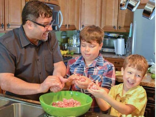 Seviche chef Anthony Lamas and his two sons cooking