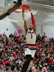 New Albany's Romeo Langford (1) dunks against Bedford
