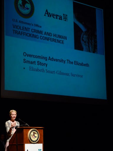 Elizabeth Smart-Gilmour speaks on overcoming adversity and her story of being kidnapped when she was 14, Wednesday at the U.S. Attorney's Office Violent Crime and Human Trafficking Conference at the Washington Pavilion, Aug 13, 2014.