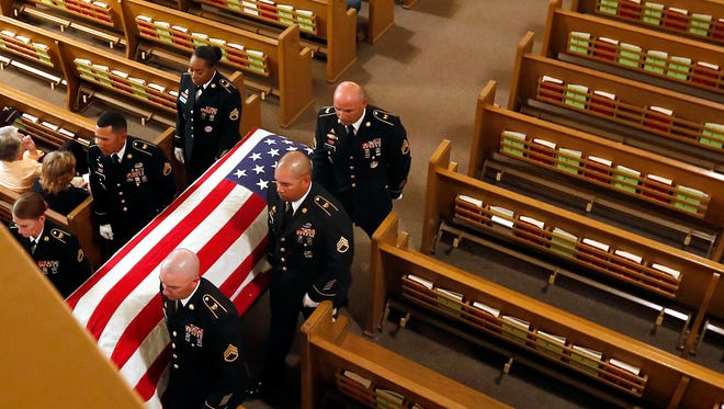 Officers from Fort Leonard Wood carry Pfc. Gerald F. Wipfli's casket from the church after his funeral service on Saturday, Sept. 23, 2017, in Nekoosa, Wis. Wipfli was reported missing in action in 1944 during World War II. His remains were found in 2010.