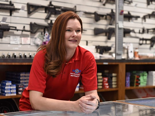 Alisha Ketter leans behind the counter at Reno Guns
