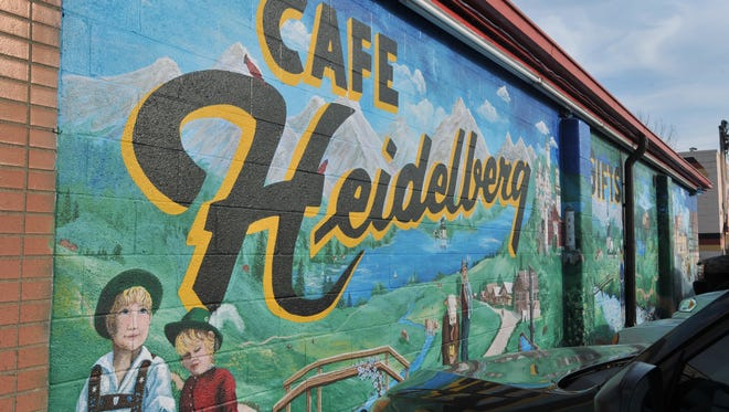 A mural decorates the east wall of Heidelberg Haus on Pendleton Pike on Dec. 3, 2012.