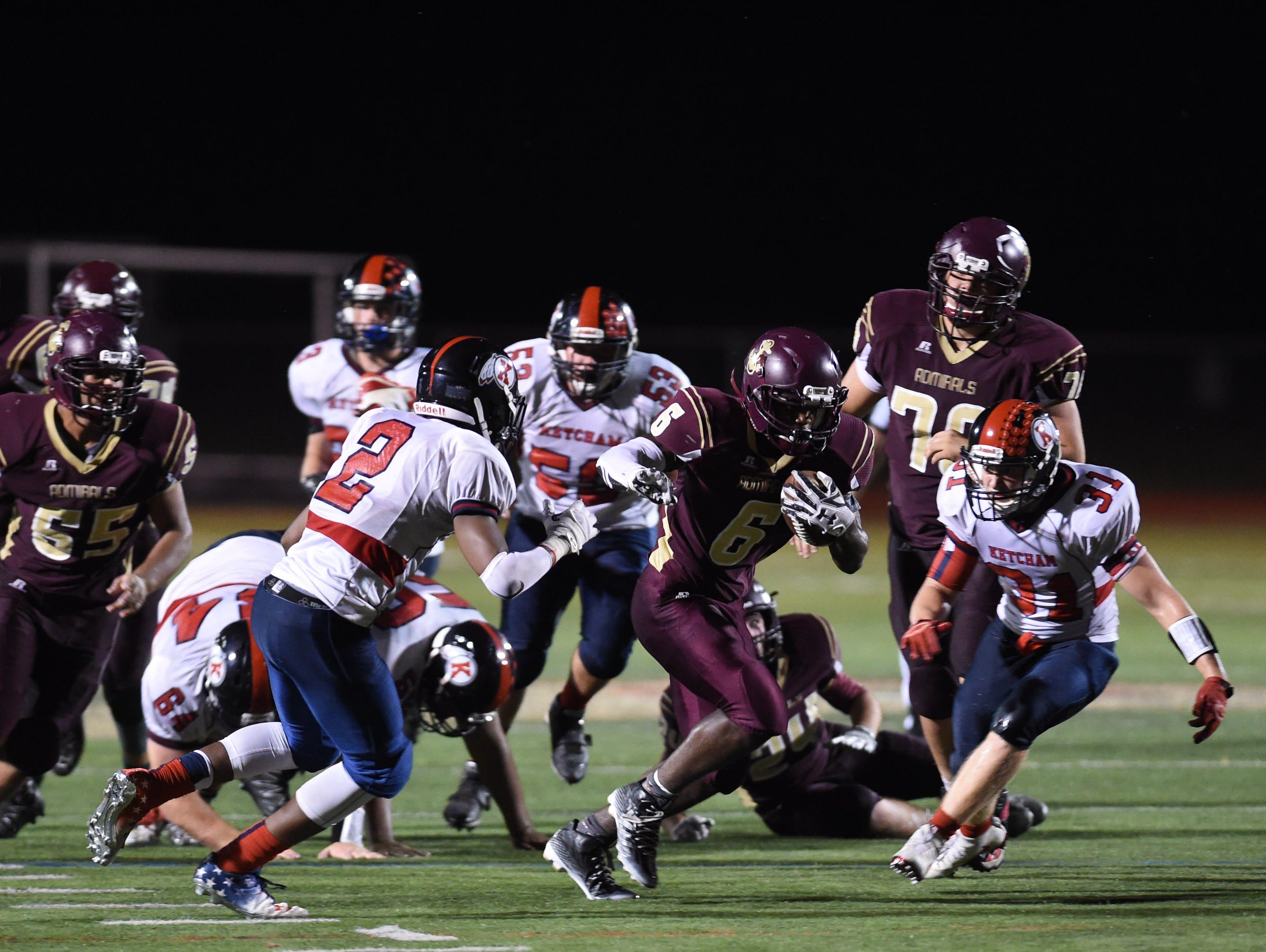 Arlington High School's Ricardo Yolas breaks through Roy C. Ketcham defenders on Friday in Freedom Plains.