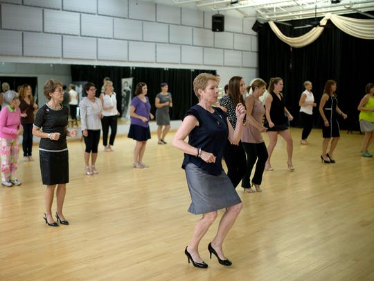 Breast cancer survivors practice at Fred Astaire Dance Studio in Bloomfield Hills.