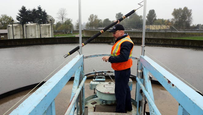 Craig Budrow, wastewater operator with the City of Salem, at Salem's Willow Creek sewage treatment plant along the Willamette River.
