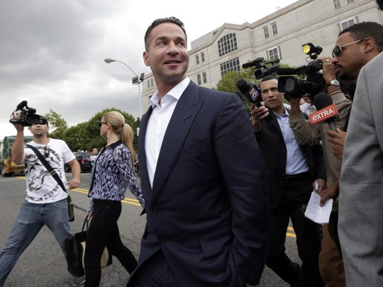 """Reporters gather around Michael """"The Situation"""" Sorrentino as he leaves a court appearance in Newark in 2014 on federal tax fraud charges."""