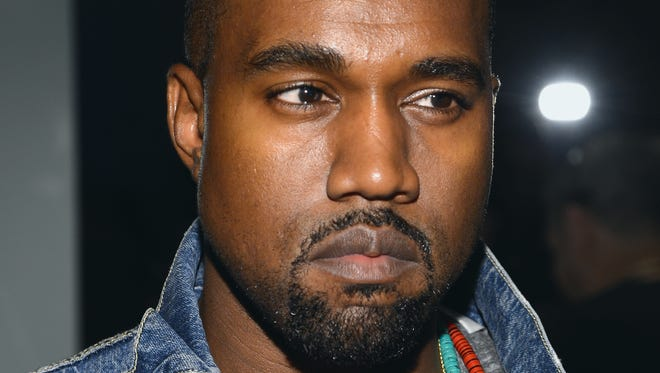 He's happy on the inside: Kanye West attends the 2013 MTV Video Music Awards in New York City.