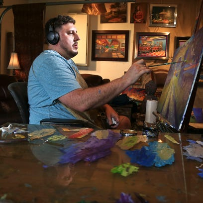 He was addicted to pills. His town was plagued by HIV. Now, he paints life in new light