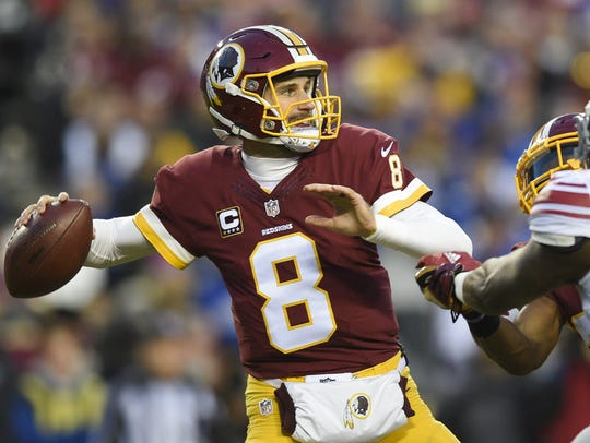 In this Jan. 1, 2017, file photo, Washington Redskins quarterback Kirk Cousins (8) passes during the first half of an NFL football game against the New York Giants, in Landover, Md.  (AP Photo/Nick Wass, File)