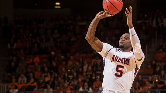 Auburn forward Cinmeon Bowers has 20 points and 18 rebounds in a 83-77 win over Alabama.