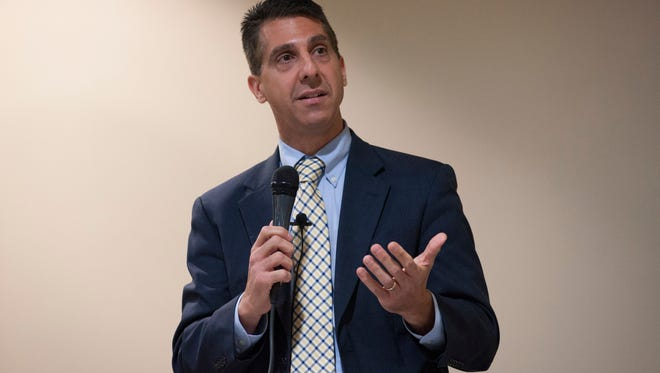 Jeff Domenico speaks at the City Commission Candidate forum at the Burnham Brook Community Center.