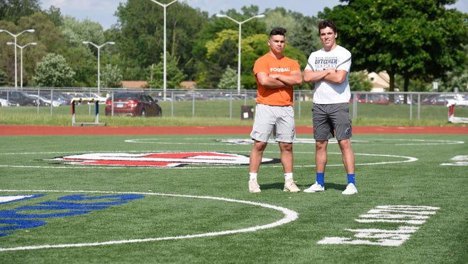 Standing one more time on the football field at Plymouth-Canton Educational Park are lifelong friends Lou Baechler (left) and Ryan Young. Both played high school football, for Canton and Salem, respectively. Now they will be reunited at Hope College.