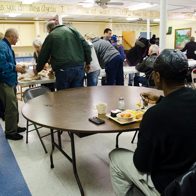 Jimmie Jenkins eats lunch by himself at Mid-City Nutrition