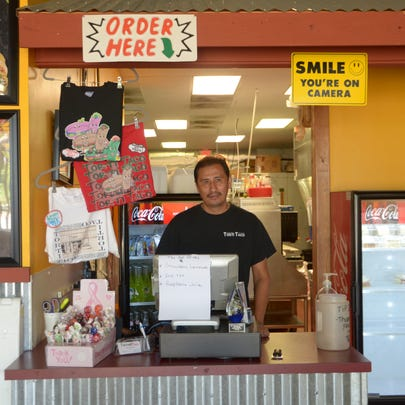 Javier Fortoso, the owner of Torti Taco, stands at