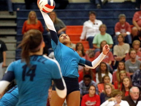 Siegel's Asha Phillips (7) hits the ball over the net